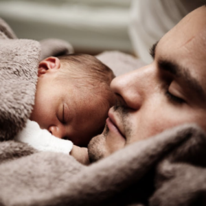 Baby and father sleeping